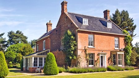 Swanton Cottage was built in 1840 and is set in five acres of mature gardens and wood (photo: Tony H