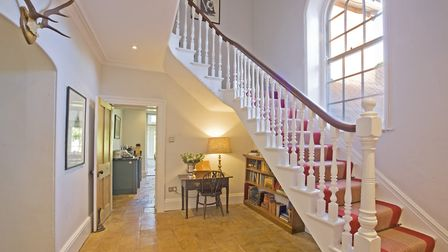 The hall is painted in Strong White by Farrow and Ball with All White woodwork and ceiling. The stai