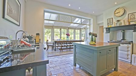 The kitchen units are all painted Incrya Blue from Farrow & Ball (photo: Tony Hall)