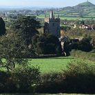 A view of Glastonbury Tor from behind the Church of St Nicholas at West Pennard