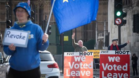 Leave and Remain protesters outside the Houses of Parliament. Picture: PA Wire/PA Images