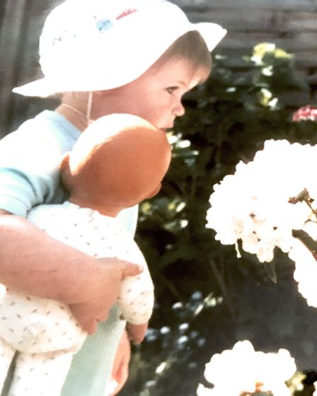 Lucy as a toddler in her garden (photo: Lucy Belsey)