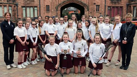 Teachers, Andrea Donaghy (left) and Lindsey Tait with Bolton School Under 12s and 13s lacrosse teams