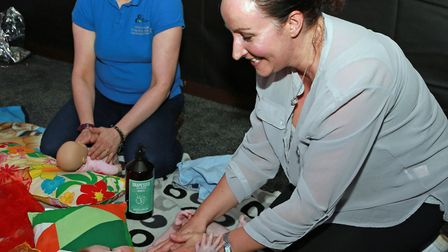 Holistic therapist Emma King (left) with Nicola Loveridge and baby Freddie enjoying a massage treatm