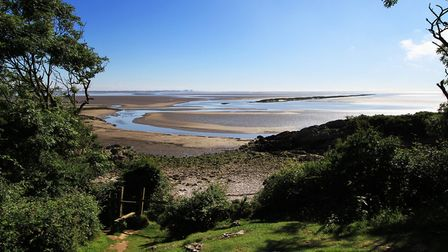 Little Cove on a sunny day in Silverdale by Nigel Hunter