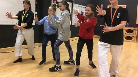 Pupils taking part ina self-defence display