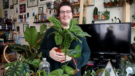 Ellie among some of her plants pictured with a calathea zebrina