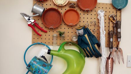 Potting tools displayed on the wall for easy access