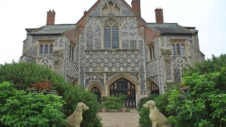 Butley Priory's impressive front with its armorial frieze