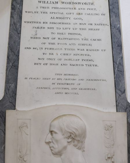 A commemorative plaque to William Wordsworth in St Oswalds Church in Grasmere