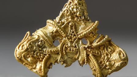 A gold brooch, found in Attleborough, is in the new Viking exhibition at Norwich Castle (picture: Da
