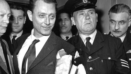 Dr Stephen Ward, society osteopath and key figure in the Profumo affair, leaves a hearing at Maryleb