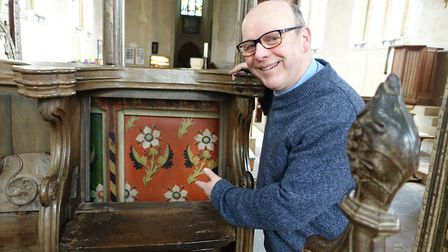 Famous screen: Rector of St Helen's, the Rev Canon Nick Garrard, shows the east side of the Ranworth