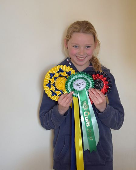 Ellie Beach with some of the rosettes she has won