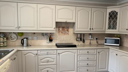 After: Transform your tired looking kitchen with stunning results.