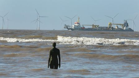 Antony Gormley's statues look out to sea