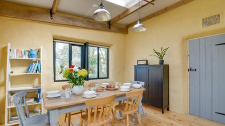 The country cottage feel is reflected in the ochre walls