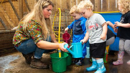 Filling the water canisters for the livestock