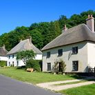 Charming thatched cottages in the village of Milton Abbas. Photo credit: CaronB/Getty Images/iStockp