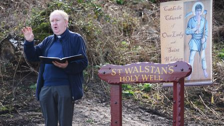 Father David Ward, priest of Our Lady of St Walstan's at Old Costessey, leads the service for the bl