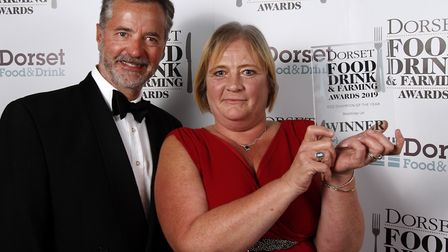 Eco Champion of the Year winner, Beewrap UK, Julie Woodward holds their award, with Simon Gudgeon of