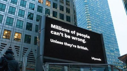 An advert from Bitpanda appears in Canary Wharf. Photograph: Supplied.