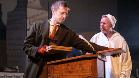 Pete Ashmore (Bob Cratchit) and Darren Lawrence (Scrooge). Photo by Steven Barber.