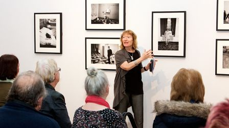 Anne describes a picture in an exhibition to an audience of people with visual impairments