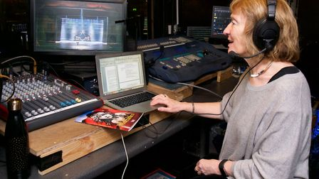 Anne Hornsby in the lighting box giving her audio description of a production to blind or visually i