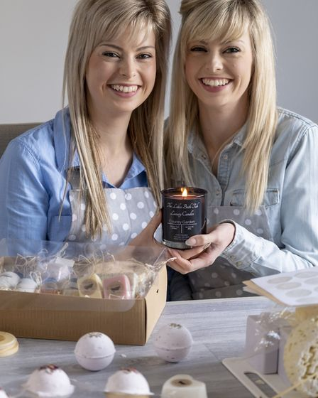 Twin Soapstars Emma (left) and Sarah Whiting produce soy candles which can be used to massage the skin for The Lakes Bathtub Co