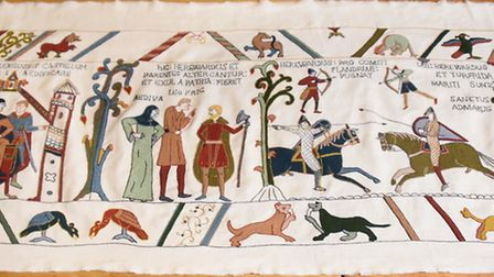 THe first panel of the modern Bayeux-style tapestry being made at Norwich Castle using the Bayeux St