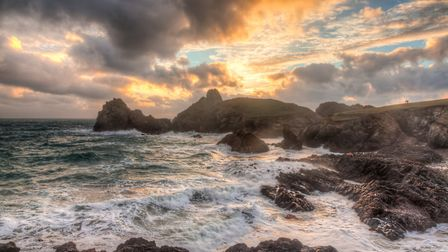 Stormy winters sunset at Kynance Cove