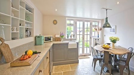 Kitchen cabinets made by Richard McColl. Tiles above range are by Zellige. Tables and chairs from Sn