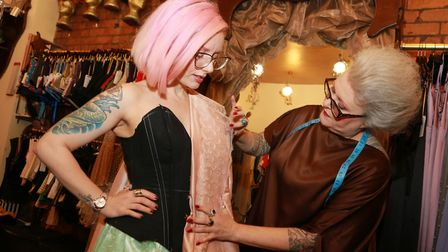 Lynn McKay of Kiku Boutique takes the measurements of Ewa Allen to have a corset hand made