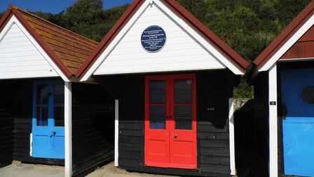 The beach hut with its blue plaque