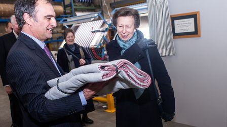 David Collinge, chairman of John Spencer Textiles presenting a gifted woven throw to HRH Princess Ro