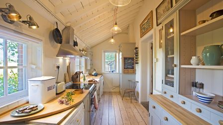 Kitchen units handmade by Chris Yaxley, The Wood Shed, Matlaske, 01263 577444; pendants from Retro