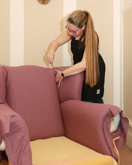 Reupholstering an armchair for a client