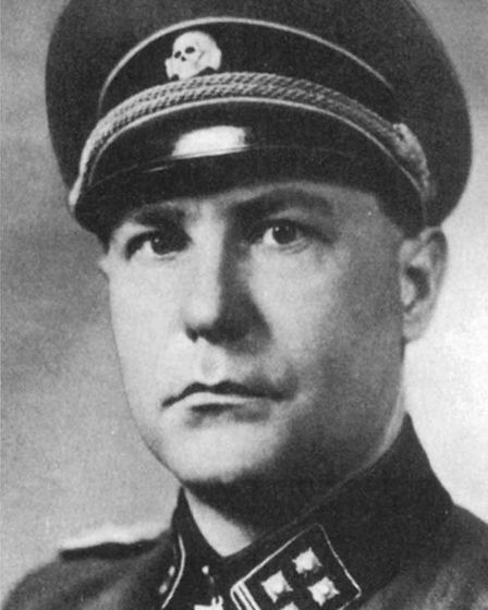 Hauptsturmfuehrer Fritz Knoechlein was put on trial three years after VE Day for his part in the Le