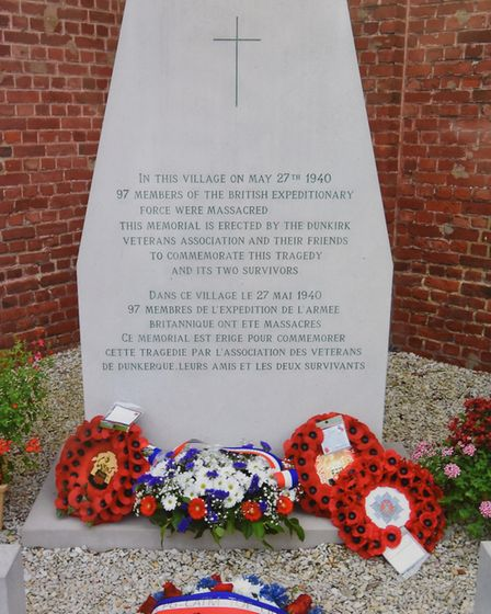 The memorial to those who were massacred, mostly Royal Norfolks, at the village church in Le Paradis