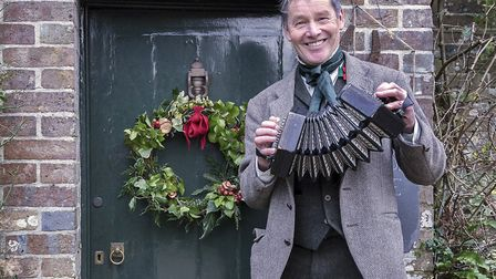 Tim Laycock in Hardy Christmas mode outside Hardy's Cottage at Higher Bockhampton