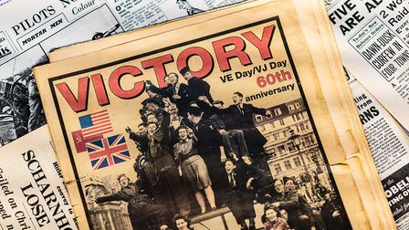 Newspaper front pages show the day the Germans surrendered. (c) Shutterstock