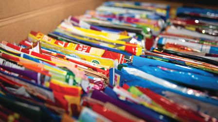 A colourful array of crisp packets ready to be shipped back to Walker's Crisps