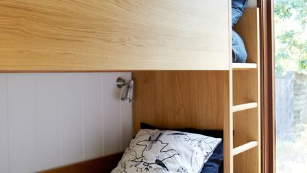 The children's bedroom makes economic use of space. GAP Interiors/Graham Atkins-Hughes