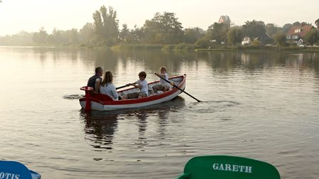 Taking a boat out on the meare is a favourite way to spend time together. GAP Interiors/Graham Atki