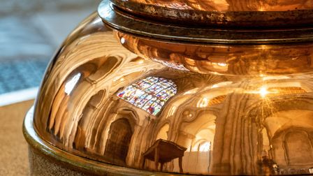 Reflections in Norwich Cathedral's copper font, made from two chocolate mixing bowls from the Rowntr