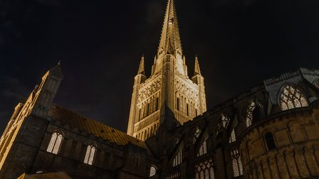 The floodlight cathedral spire pierces the night sky. Photo: Bill Smith