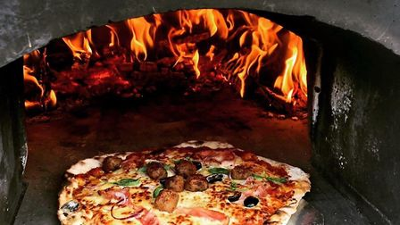 A delicious pizza in Mark Fitch's outdoor oven. Photo Mark Fitch