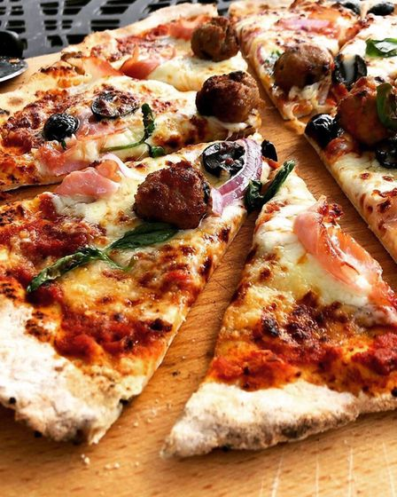 Mouth-watering pizza from the outdoor oven. Photo Mark Fitch