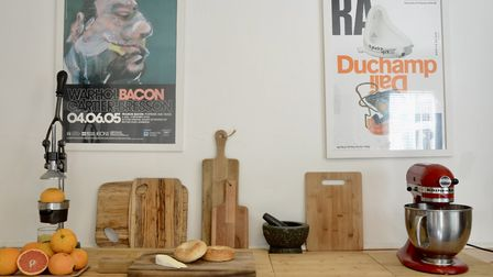 The kitchen walls feature posters from art exhibitions we've visited